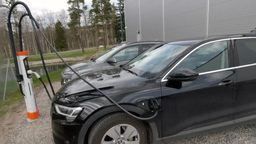 ETron is charging while the satellite pole with the CCS connector is on the right side of the car, the car charging port is on the left side and the car is parked left from the satellite pole. This trick does not work with a standard fast charger